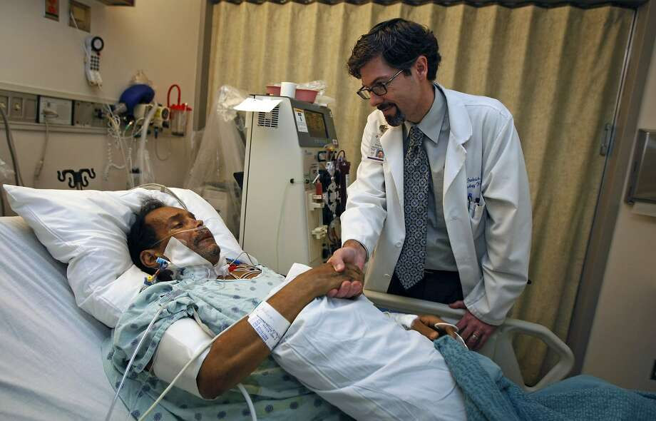 California Pacific Medical Center Doctor Todd Frederick who leads a team through phase two of a clinical trial, testing a device named Elad that keeps patients with acute liver failure alive, visits one of his patients Eddy Lopez who is recovering in ICU after a liver transplant Tuesday June 30, 2009. Photo: Lance Iversen, The Chronicle