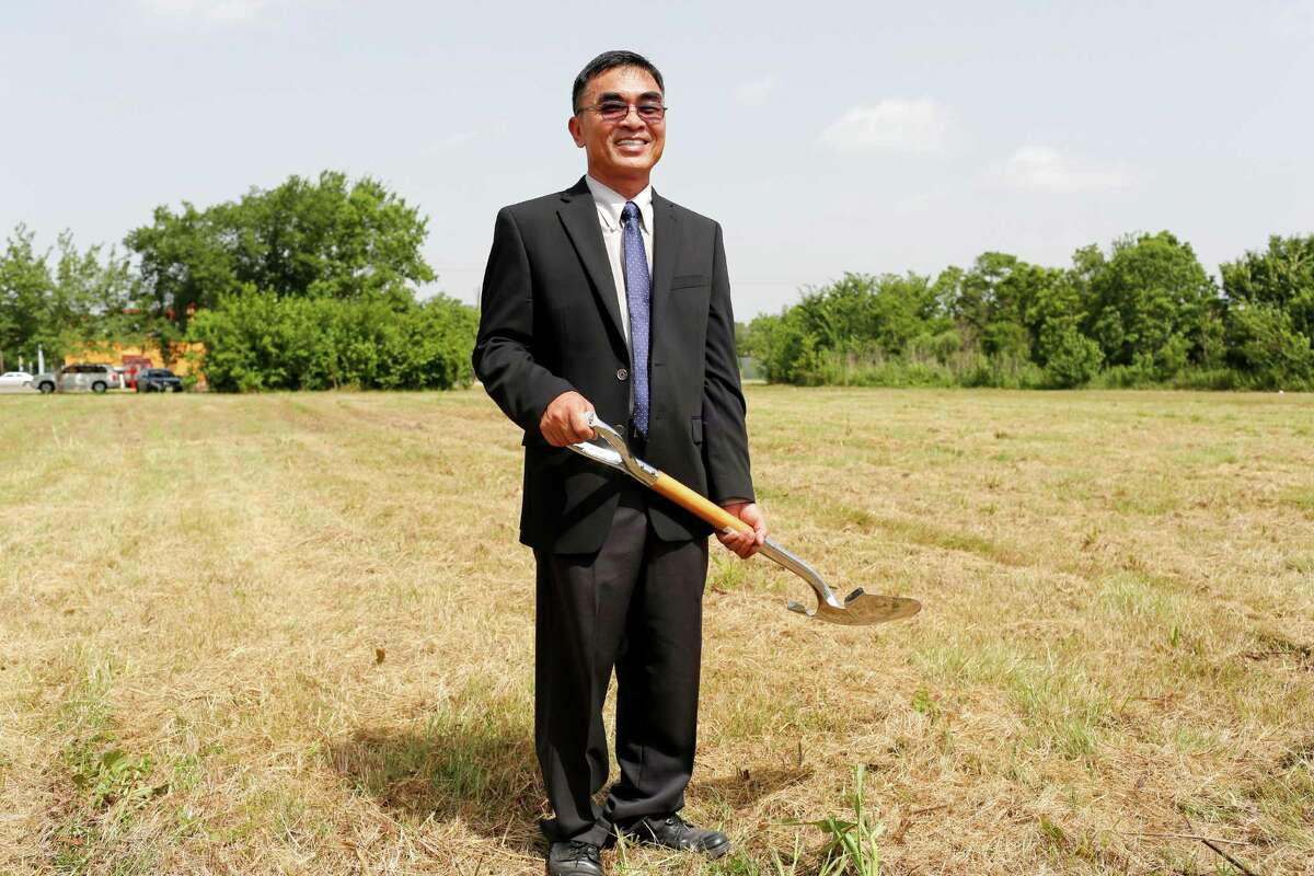 John Vuong stands where he will break ground on his 12th supermarket June 30, 2014 in Houston at the corner of Corder and Scott. The area is considered a food desert, with very few shopping options for fresh food, local residents whom are often without reliable transportation, must travel long distances for healthy food choices. (Eric Kayne/For the Chronicle)