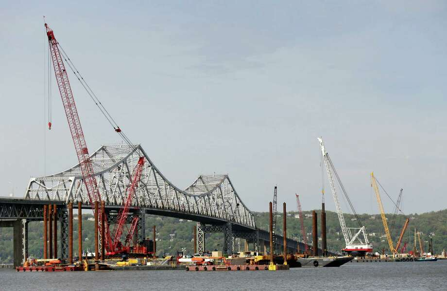 FILE--In this May 13, 2014 file photo, construction crews use barges and cranes as work continues on a replacement for the 58-year-old Tappan Zee Bridge spanning the Hudson River near Tarrytown, N.Y. The New York State Environmental Facilities Corp. has approved Gov. Andrew Cuomo's plan to use $511 million in loans from a clean water fund to help finance the new bridge. It's now subject to approval by the Thruway Authority and Public Authorities Control Board.(AP Photo/Julie Jacobson, File) ORG XMIT: NYMG103 Photo: Julie Jacobson / AP