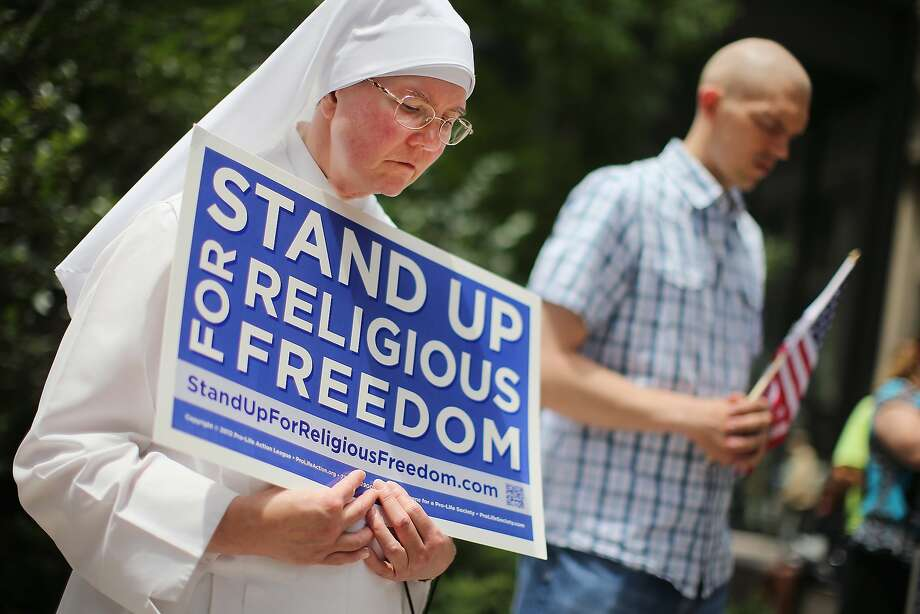 Sister Caroline (L) attends a rally with other supporters of religious freedom to praise the Supreme Court's decision in the Hobby Lobby, contraception coverage requirement case on June 30, 2014 in Chicago, Illinois. Photo: Scott Olson, Getty Images