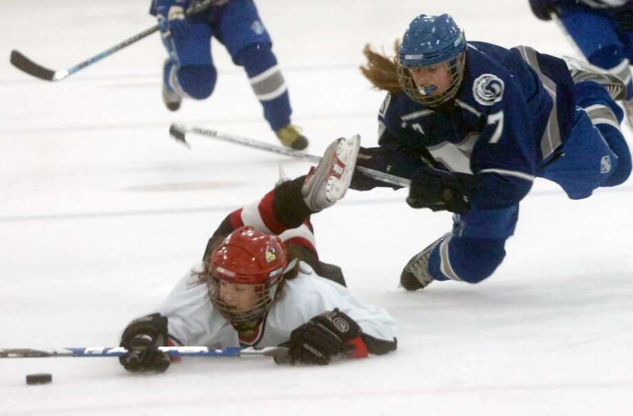 Greenwich's Hannah Jeffrey and Darien's Lily Christensen battle as Greenwich High hosts Darien in a girls ice hockey game at Dorothy Hamill in Byram, CT, Tuesday evening, Feb 16, 2010. Darien won the game in overtime 2-1. Photo: Keelin Daly / Greenwich Time