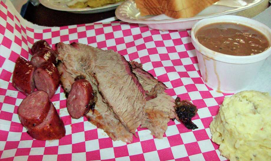 Brisket, sausage, beans and potato salad are typical fare at Harmon's BBQ in Cibolo. Photo: Dining Divas / For The Northeast Herald