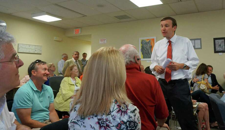 U.S. Senator Chris Murphy speaks with residents concerned about the rumored closing of the Southport Post Office. Photo: Genevieve Reilly / Fairfield Citizen