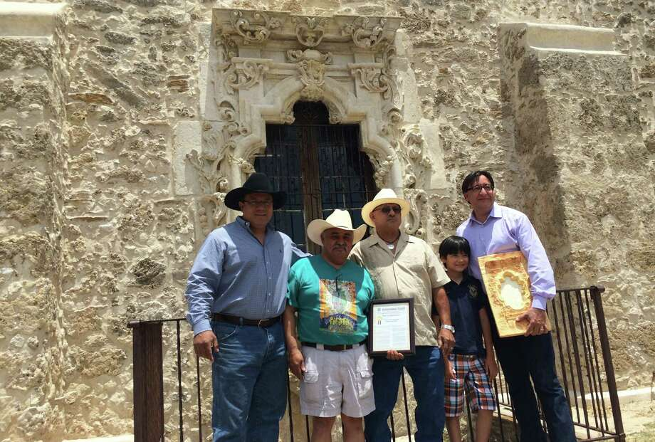 U.S. Rep. Pete Gallego recently presented a congressional document to ancestors of Pedro Huízar at Mission San José. From left are Edward Huízar; Jerry Huízar; Pedro Huízar; Nicholás Miguel Ramon Gallego, the congressman's son; and the congressman. The elder Pedro Huízar was a San Antonio artist and surveyor believed to be behind the mission's famed Rose Window. Photo: Courtesy Photo