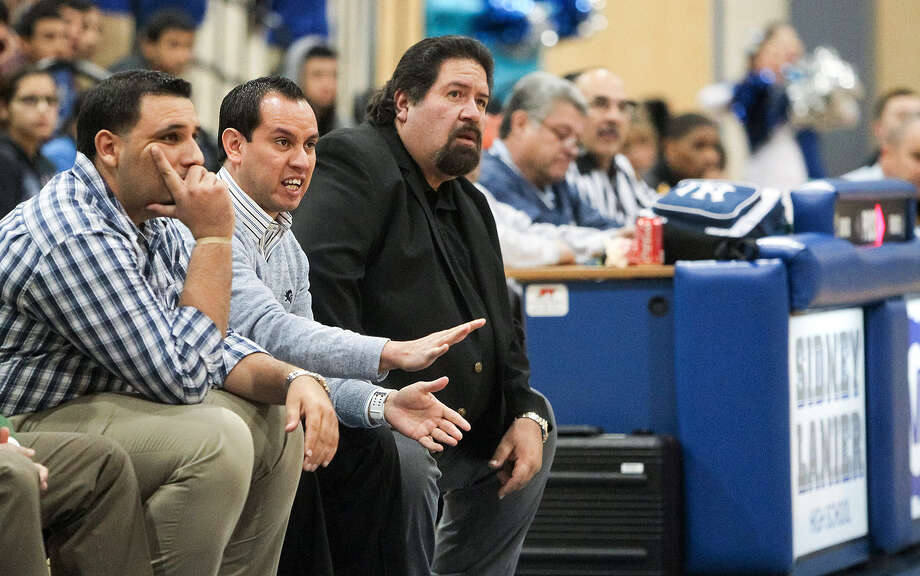 Then-assistant Lanier coach Joseph Martinez, second from left, gestures at players during a January game. Martinez has been named Voks basketball coach, succeeding retiring Rudy Bernal (in black). At left is returning assistant coach Martin Cardenas. Photo: Marvin Pfeiffer / Southside Reporter / Express-News 2013