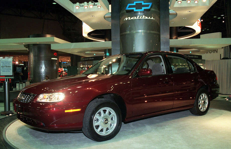 "File-This March 27, 1997, file photo shows 1998 Chevrolet Malibu at the media preview of the New York International Automobile Show.  General Motors' safety crisis worsened on Monday, June 30, 2014, when the automaker added 8.2 million vehicles to its huge list of cars recalled over faulty ignition switches. The latest recalls cover seven vehicles, including the Chevrolet Malibu from 1997 to 2005 and the Pontiac Grand Prix from 2004 to 2008. The recalls also cover a newer model, the 2003-2014 Cadillac CTS. GM said the recalls are for ""unintended ignition key rotation."" (AP Photo/Ed Bailey, File) ORG XMIT: NY112 Photo: Ed Bailey / AP"