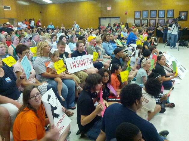 Beaumont ISD trustees failed to pass a proposed reduction in force on Monday after the board majority abstained from the vote. A large crowd attended Monday's board meeting that addressed layoffs and the closing of Austin Middle School.   Guiseppe Barranco/The Enterprise