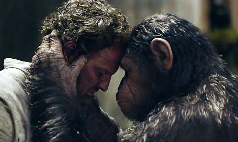 "Jason Clarke (left) has a meeting of the minds in the sequel ""Dawn of the Planet of the Apes."" Photo: 20th Century Fox"