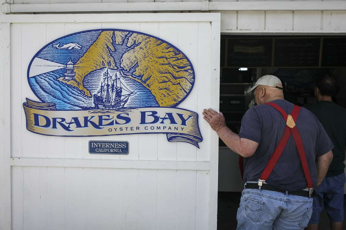 People wait in line at Drakes Bay Oyster Farm in Inverness on June 30th 2014. The U.S. Supreme Court decided not to hear the farm?•s challenge to its proposed closure by federal authorities, on June 30th 2014.