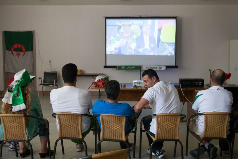 A group of around 30 Algerians watched the Algeria vs. Germany round of 16 match at the Arab Cultural Center in San Jose. Photo: Douglas Zimmerman, Courtesy