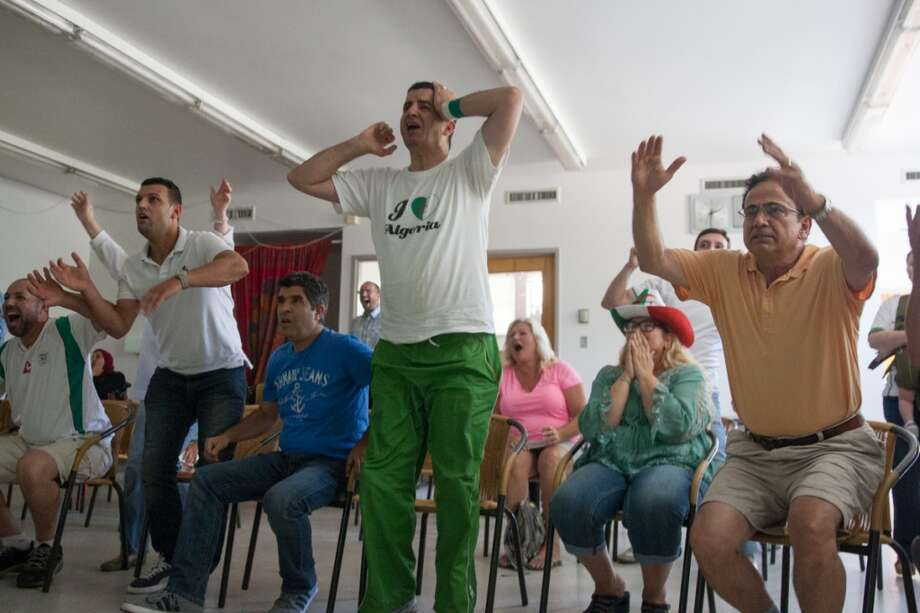 Every time Algeria came close to scoring the fans jumped out of their seats. Photo: Douglas Zimmerman, Courtesy