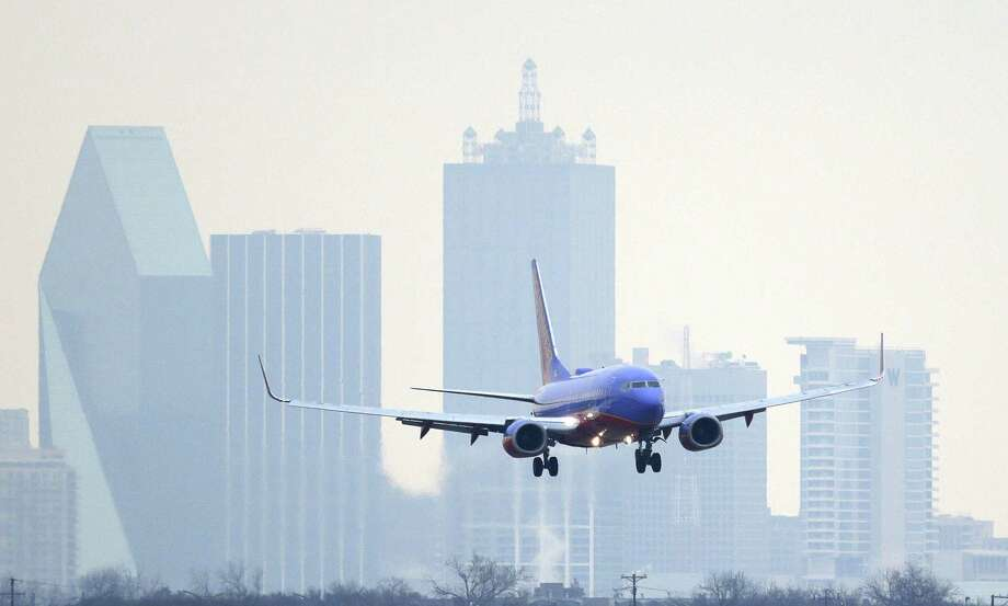 In this Feb. 3, 2014 file photo, a Southwest Airlines jet plane lines up for a landing at Love Field in Dallas. Photo: LM Otero, Associated Press / AP