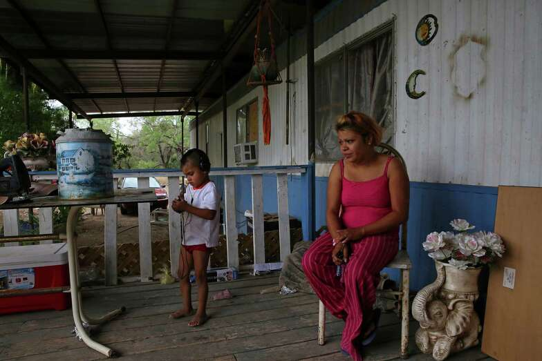 Judy Vargas, 28, with her son Isaac, 5, lives in a trailer with her three children, her grandmother, and at times other relatives in Gardendale, a colonia near Cotulla in South Texas.