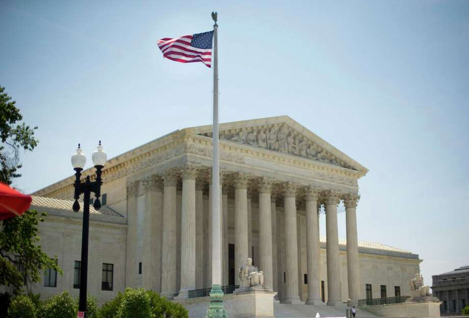 The Supreme Court building in Washington, Monday, June 30, 2014, following various court decisions. The court ruled on birth control, union fees and other cases. (AP Photo/Pablo Martinez Monsivais) ORG XMIT: DCPM110 Photo: Pablo Martinez Monsivais / AP