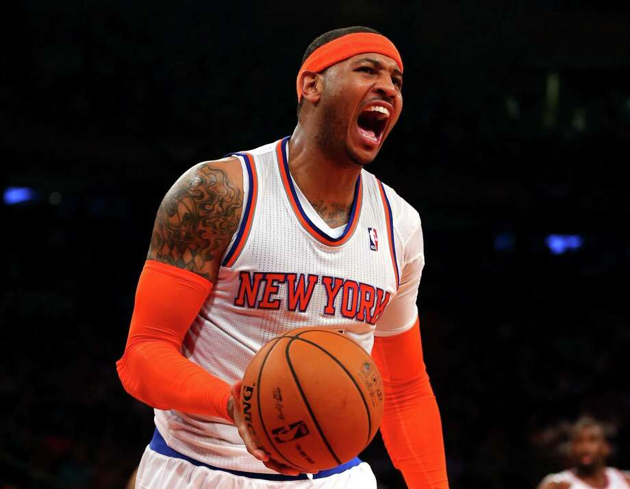 Will Carmelo Anthony rejoin the Knicks, or will he shun the money and glamour of the Big Apple and go elsewhere? Photo: Elsa / Getty Images / 2013 Getty Images