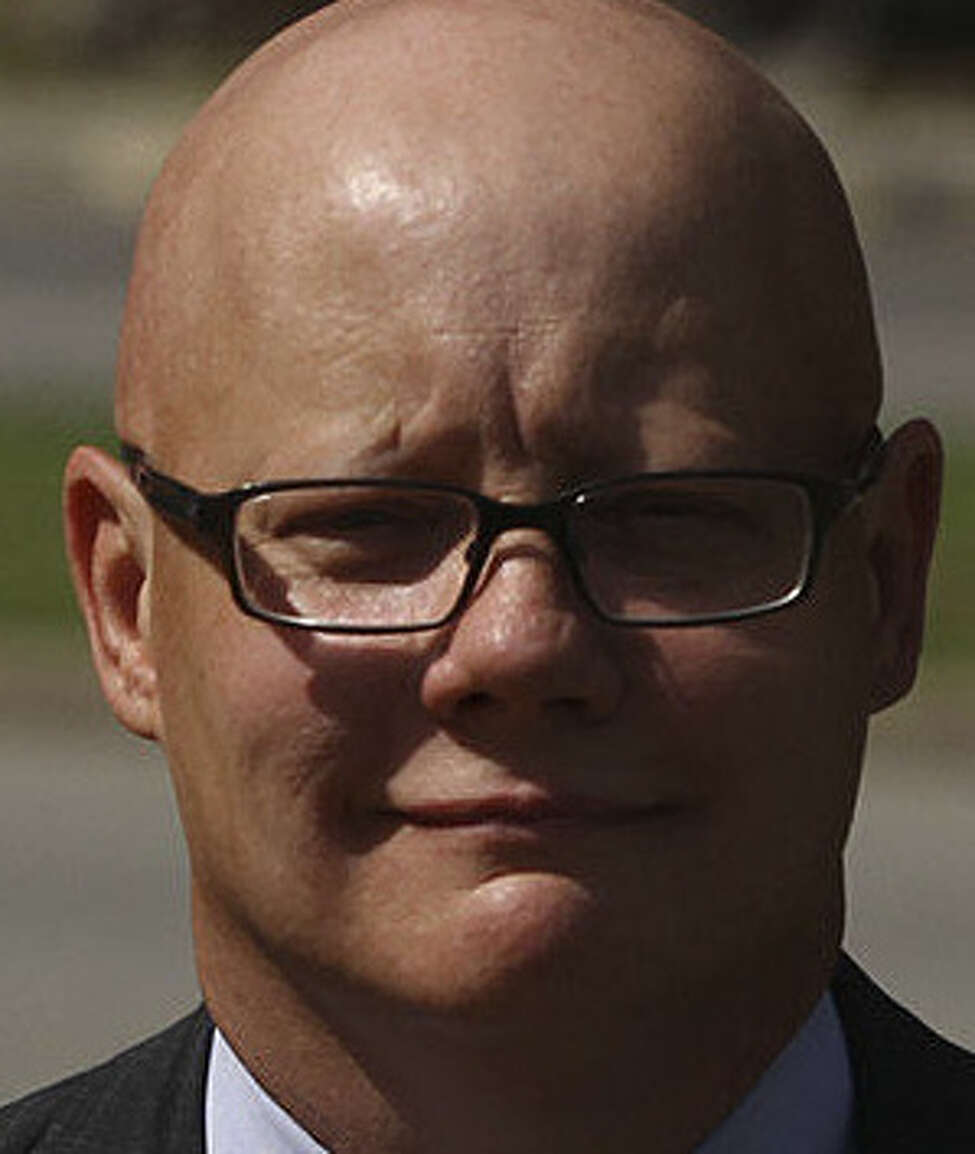 Ex-District Judge Angus McGinty is accused of taking bribes for rigging cases.