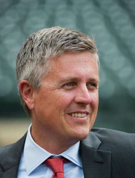 Houston Astros general manager Jeff Luhnow watches batting practice before an exhibition game against the Chicago Cubs at Minute Maid Park on Friday, March 29, 2013, in Houston. ( Smiley N. Pool / Houston Chronicle ) Photo: Smiley N. Pool / © 2013  Smiley N. Pool