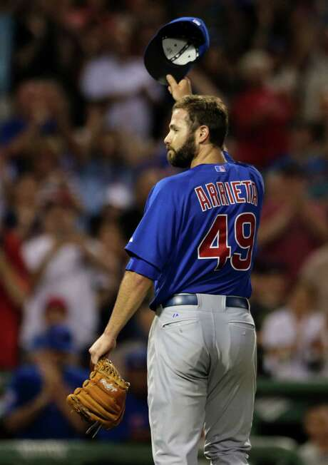 The Cubs' Jake Arrieta gets a standing ovation as he leaves Monday's game after pitching 72⁄3 innings of one-hit ball. Photo: Charles Krupa, STF / AP