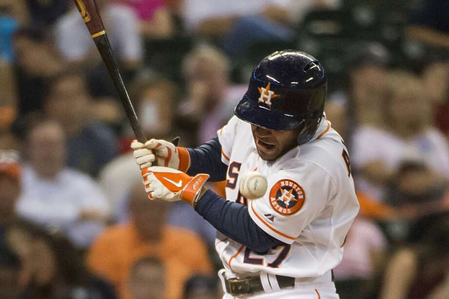 June 30: Mariners 10, Astros 4Astros second baseman Jose Altuve grimaces as he is hit by a pitch from Mariners starting pitcher Taijuan Walker during the fifth inning. Photo: Smiley N. Pool, Houston Chronicle