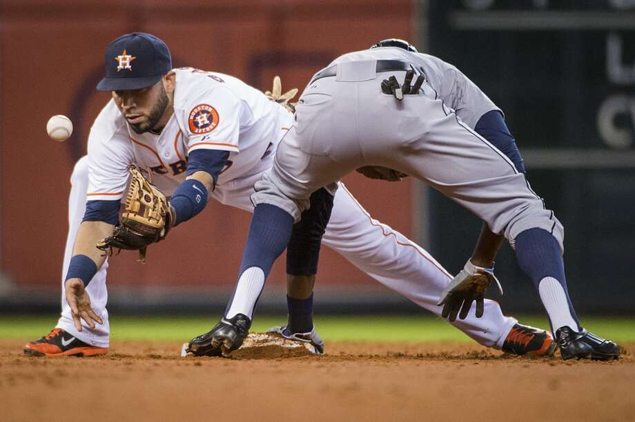 The ball gets away from Astros shortstop Marwin Gonzalez as Mariners center fielder James Jones is safe at second base with a stolen base during the third inning. Photo: Smiley N. Pool, Houston Chronicle