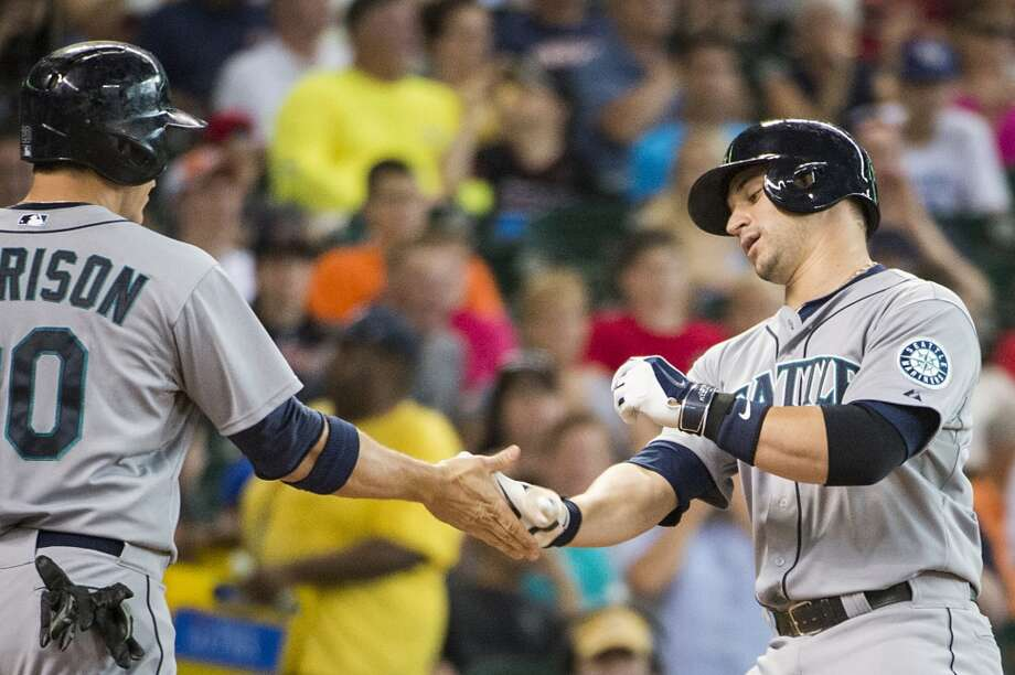 Mariners catcher Mike Zunino celebrates with first baseman Logan Morrison after hitting a two-run home run during the second inning. Photo: Smiley N. Pool, Houston Chronicle