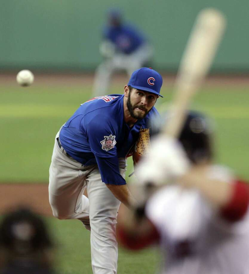 Chicago Cubs starting pitcher Jake Arrieta delivers against the Boston Red Sox during the first inning of a baseball game at Fenway Park in Boston, Monday, June 30, 2014. (AP Photo/Charles Krupa) ORG XMIT: MACK101 Photo: Charles Krupa / AP