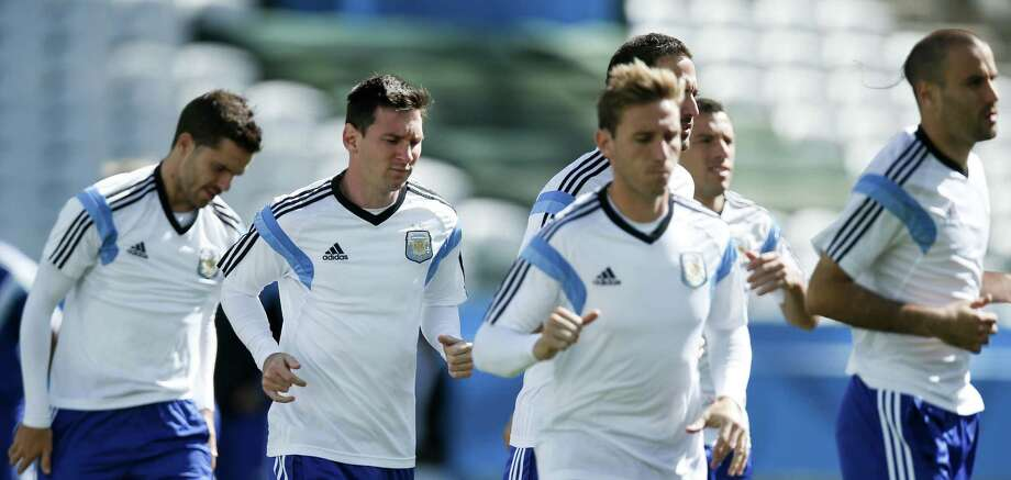 Lionel Messi (second from left), jogging with teammates, has scored four of Argentina's six goals during the World Cup. Photo: Victor R. Caivano / Associated Press / AP