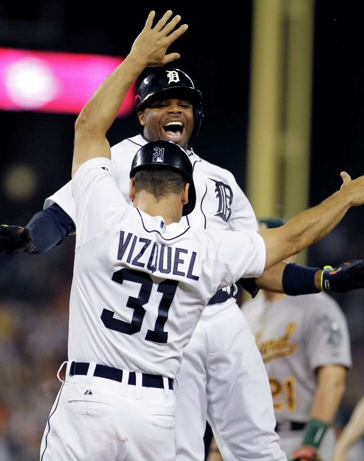 Detroit Tigers' Rajai Davis celebrates with first base coach Omar Vizquel after hitting a walk-off grand slam in the ninth inning to beat the Oakland Athletics 5-4 in a baseball game Monday, June 30, 2014, in Detroit. (AP Photo/Duane Burleson) ORG XMIT: DTS112 Photo: Duane Burleson / FR38952 AP