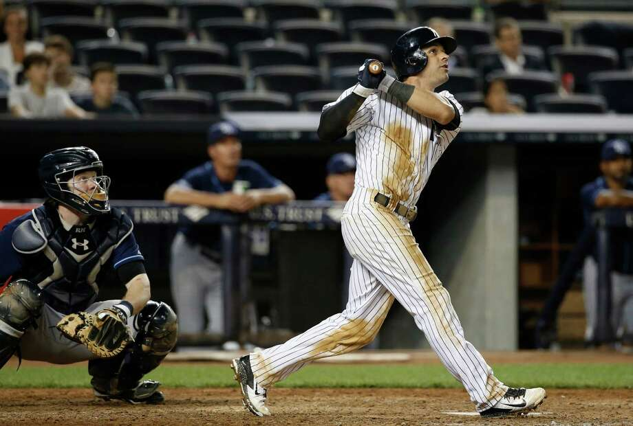 New York Yankees Brian Roberts hits a ninth-inning, game-tying solo home run in a baseball game against the Tampa Bay Rays at Yankee Stadium in New York, Monday, June 30, 2014.  (AP Photo/Kathy Willens) ORG XMIT: NYY117 Photo: Kathy Willens / AP