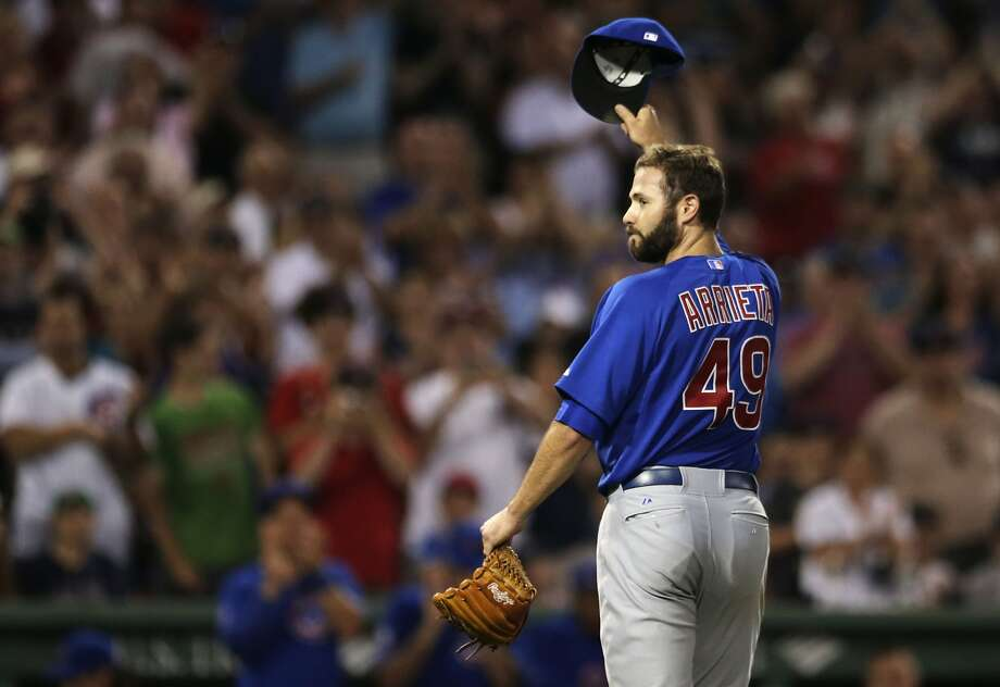 Jake Arrieta held the Red Sox hitless Monday night until Stephen Drew singled with two outs in the eighth inning as the Chicago Cubs won 2-0 in Boston. Photo: Charles Krupa, Associated Press