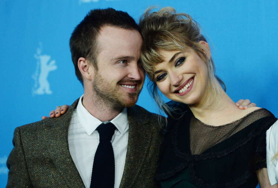 Aaron Paul and Imogen Poots, the stars of NEED FOR SPEED, which is appealing, though it has none of the six tendencies. Photo: PATRIK STOLLARZ, AFP/Getty Images / 2014 AFP