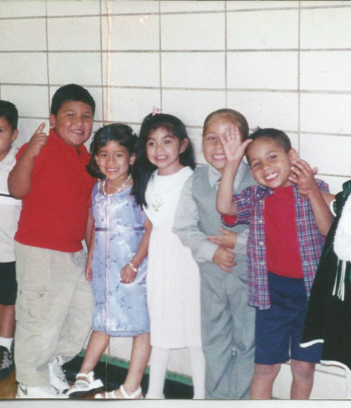 Friends (from left) Jesse Martinez, Alexis Ibarra, Marissa Hernandez, Isiah Garcia and Jordan Fernandez pose in the Kennedy High School gym back in 2000 when they were all 4 years old.