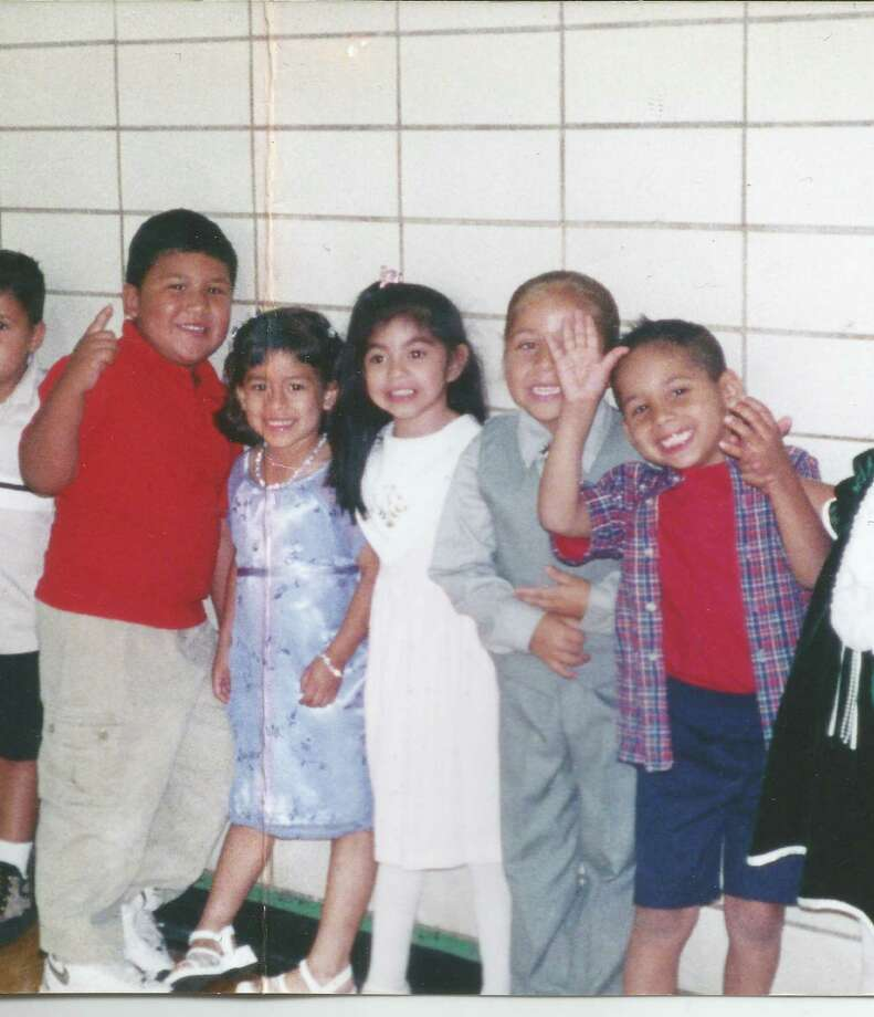 Friends (from left) Jesse Martinez, Alexis Ibarra, Marissa Hernandez, Isiah Garcia and Jordan Fernandez pose in the Kennedy High School gym back in 2000 when they were all 4 years old. Photo: Courtesy, Fernandez,  Reader Submission