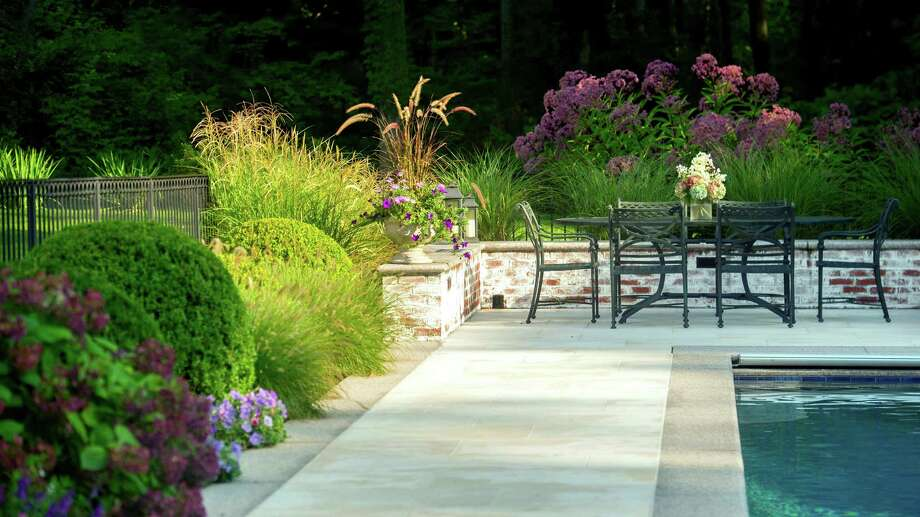 The redesign of a property in Darien was its landscape architect, Allan Broadbent, of The LaurelRock Company, of Wilton, with the 2014 International Landscape Design Award. Photo: Contributed Photo, Contributed / Darien News