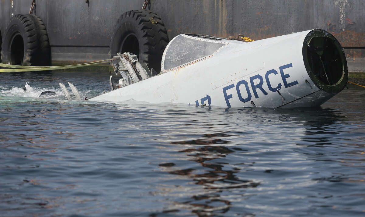 Two F-101 Voodoo planes make their last journey 74 feet deep into the gulf to become artificial reefs about 3 nautical miles off the coast on Friday, June 27, 2014, in Panama City Beach, Fla. (AP Photo/The News Herald, Heather Leiphart)