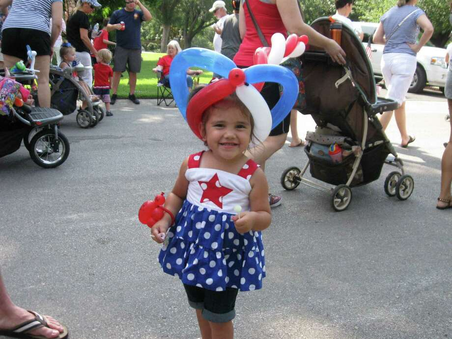 Abby Smith, 2, gets into the spirit of independence in the 2013 Terrell Hills Fourth of July parade. Photo: File Photo