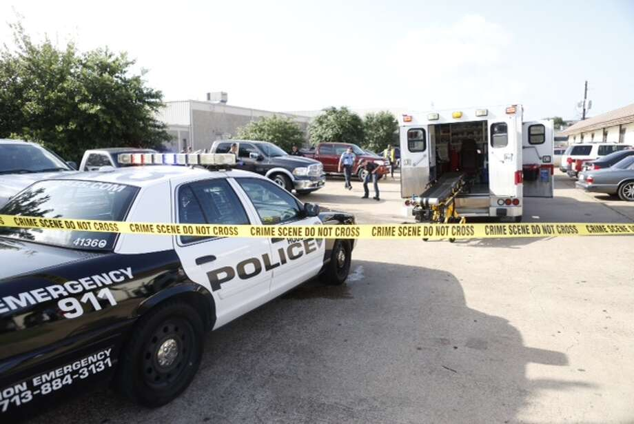 Houston police are searching for a four-door white pickup truck in connection with the ambush shooting death of a man about 8:30 a.m. Tuesday outside a business in the 4900 block of West 34th Street. Photo: Cody Duty / Houston Chronicle