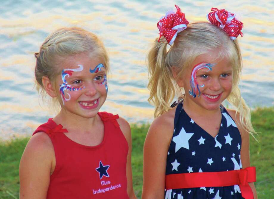 Brea, left, and Brook Stidham sport patriotic face painting during the 2013 Towne Lake Fourth of July celebration. This year's event will be 7:30-9 p.m. July 4 in the event field adjacent to Towne Lake Welcome Center, 18915 San Saba Creek in Cy-Fair. Photo: Courtesy Photo / (c) Mark W. Stephens