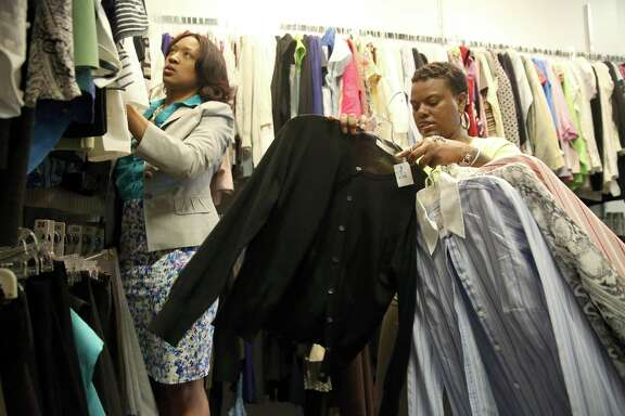 6/27/14: Alesha Walker, Program Coordinator helps Monisha Jackson put together work outfits at Dress For Success in Houston, Texas. Jackson was a Staff Sgt. Radio Operator in the US Air Force from 2000-2008. Jackson is allowed to pick 8 items to make 32 outfits for her newly appointed contact represented job at the Social Security Administration. Dress for Success Mission is to promote the economic independence of disadvantage women by providing professional attire, a network of support and career development tools to help women thrive in work and in life. (Photo by Thomas B. Shea for the Houston Chronicle).