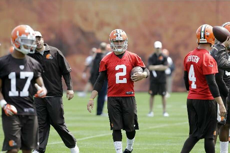 Johnny Manziel takes the ball during Browns OTAs. Photo: Mark Duncan, Associated Press