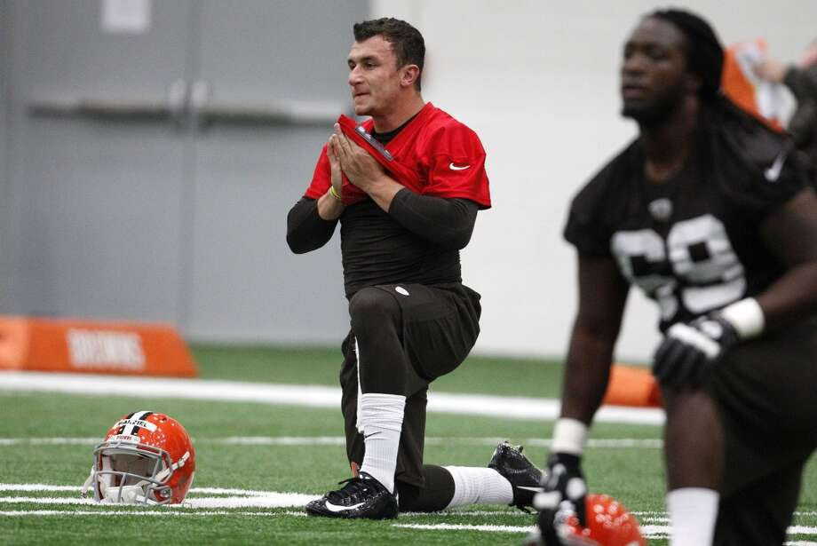 BEREA, OH - MAY 17:  Cleveland Browns draft pick Johnny Manziel #2  stretches during the Cleveland Browns rookie minicamp on May 17, 2014 at the Browns training  facility in Berea, Ohio.  (Photo by David Maxwell/Getty Images) Photo: David Maxwell, Getty Images