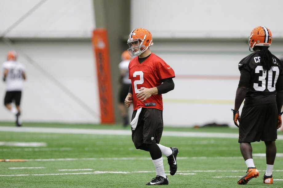 Cleveland Browns quarterback Johnny Manziel (2) during a rookie minicamp practice at the NFL football team's facility in Berea, Ohio Saturday, May 17, 2014. (AP Photo/Mark Duncan) Photo: Mark Duncan, Associated Press