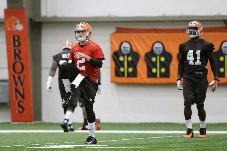 Cleveland Browns quarterback Johnny Manziel (2) warms up before a rookie minicamp practice at the NFL football team's facility in Berea, Ohio Saturday, May 17, 2014. (AP Photo/Mark Duncan) Photo: Mark Duncan, Associated Press