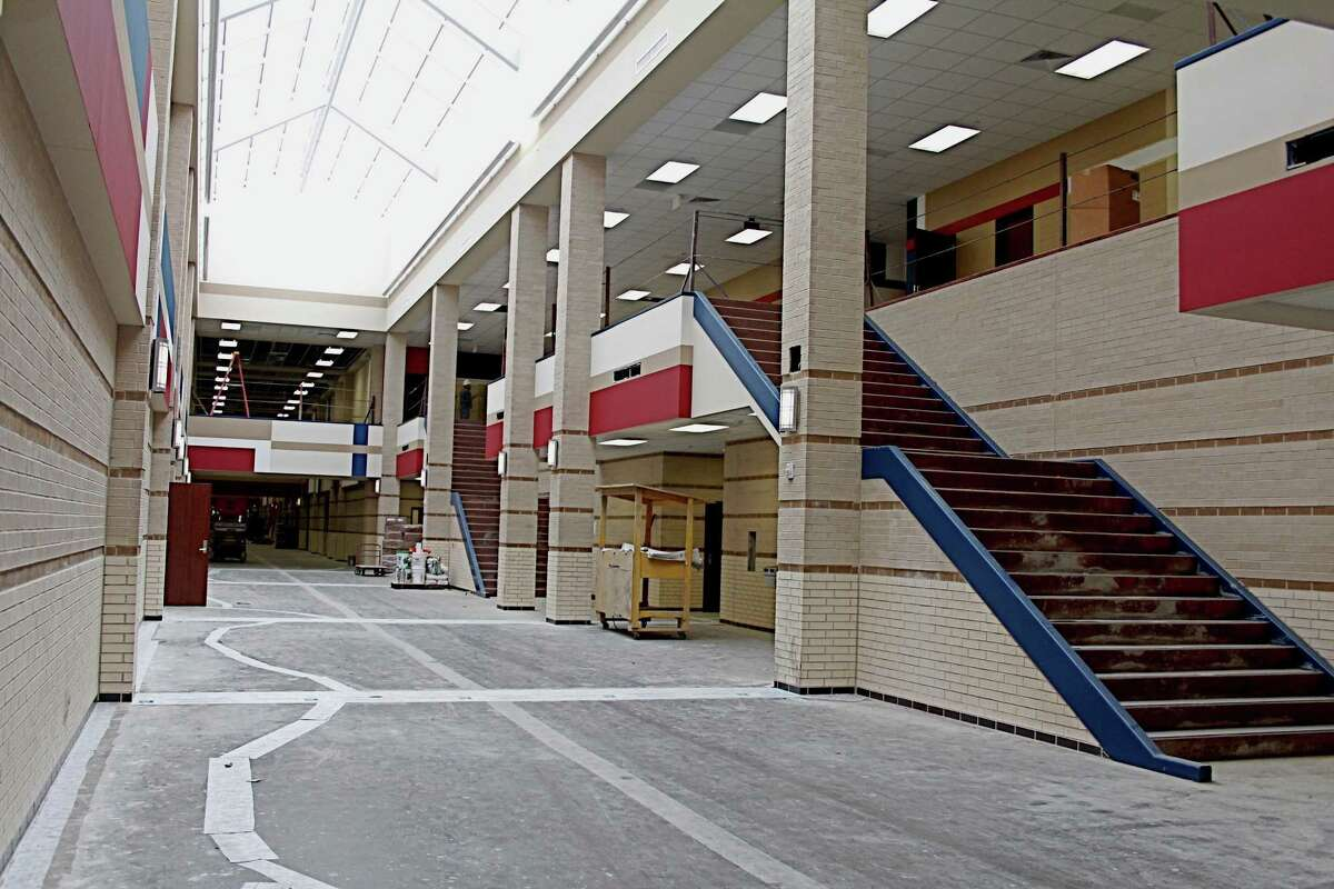 Construction of Tompkins High School at 4400 Falcon Landing Boulevard, Katy ISD's seventh high school, continues as workers complete interior finishing inside the new school. The school colors of crimson, blue and white outline the hallway. Suzanne Rehak/For the Chronicle