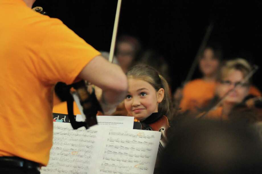 Isabelle Burkhart, 9, was a featured performer during the Fiddlers' Fair grand concert.  Isabelle Burkhart, 9, was a featured performer during the Fiddlers' Fair grand concert. Photo: Copyright Tony Bullard 2014, Freelance Photographer / Copyright 2014 Tony Bullard & the Houston Chronicle