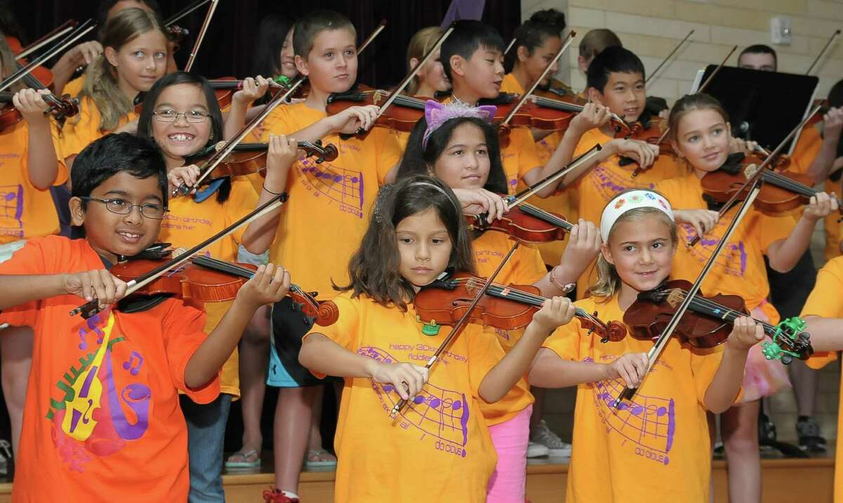 Young violinists from the Spring Branch Independent School District get the chance to shine during the concert that ended the 30th annual Fiddlers Fair, held at Frostwood Elementary School. Young violinists from the Spring Branch Independent School District get the chance to shine during the concert that ended the 30th annual Fiddlers Fair, held at Frostwood Elementary School.