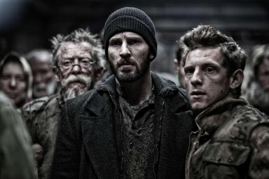 """John Hurt, from left, Chris Evans and Jamie Bell star in """"Snowpiercer."""""""
