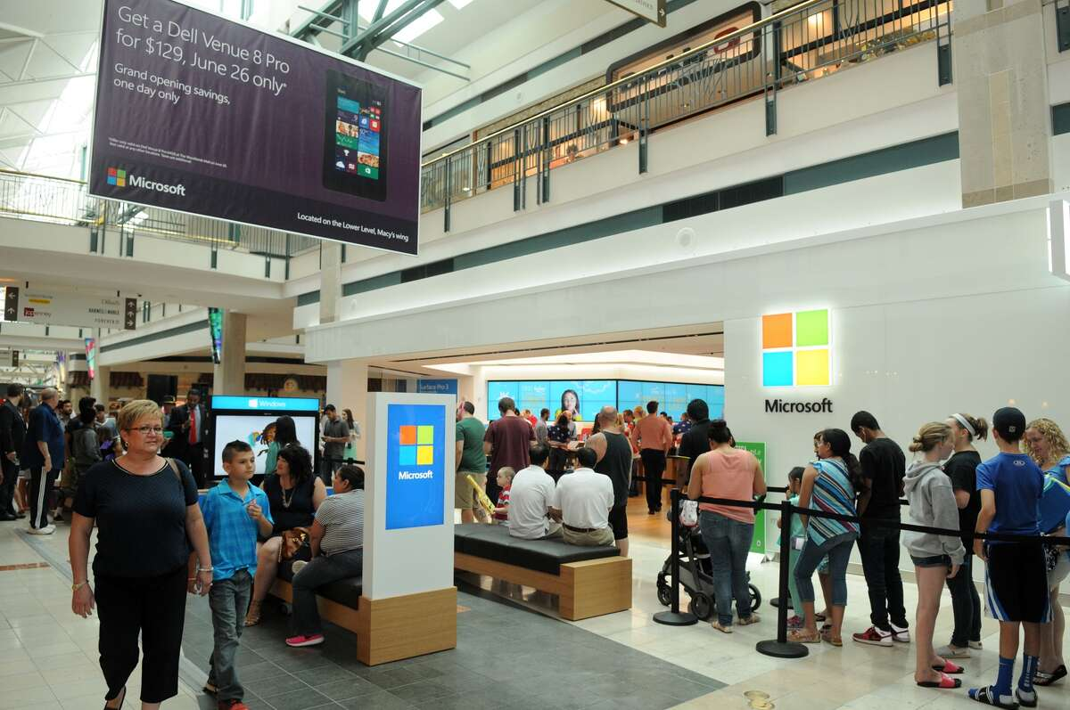People wait in line to get into the Microsoft Retail Store after the grand opening event in The Woodlands Mall on Thursday.
