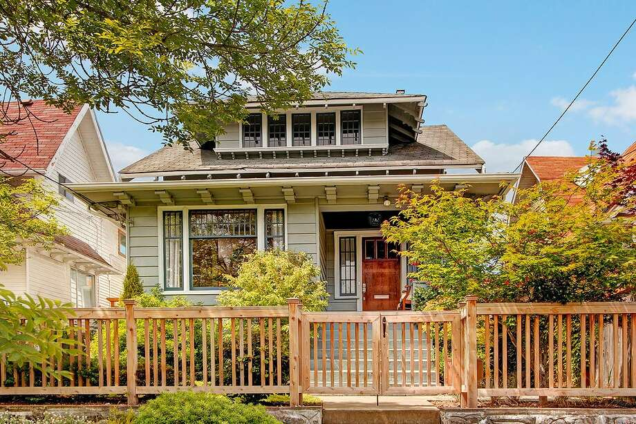 We'll start with 1121 27th Ave. The 1,900-square-foot house, built in 1905, has three bedrooms, 2.25 bathrooms, a sun room, a den, a family room, a front porch and a back deck on a 3,960-square-foot lot. It's listed for $575,000, although a sale is pending. Photo: Vista Estate Imaging,  Courtesy Terry Jones/HomeSmart Real Estate Associates