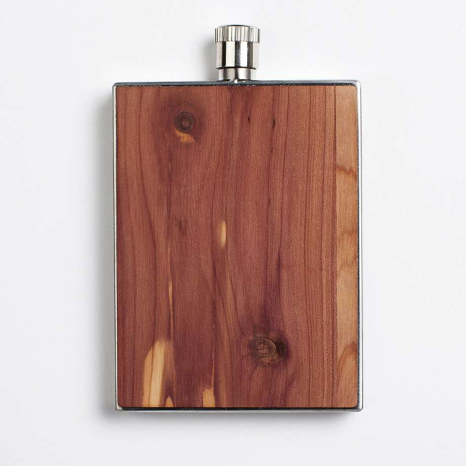 Stainless steel keeps this handmade wood flask from Woodchuck from turning into pulp. Plus, its slim and compact design keeps its presence discreet until that first sip. Customized options available.  $39.99,  http://woodchuckusa.com. Photo: Woodchuck